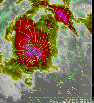Wake low - Image showing the pressure pattern around an organized thunderstorm complex. Near the strong wake low, strong winds and a temperature spike were recorded