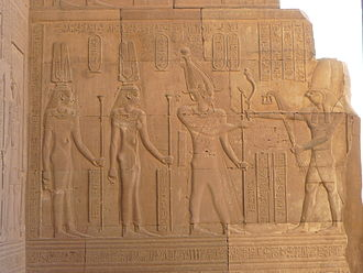 Ptolemy VIII Physcon - Wall relief of Cleopatra III, Cleopatra II and Ptolemy VIII before Horus
