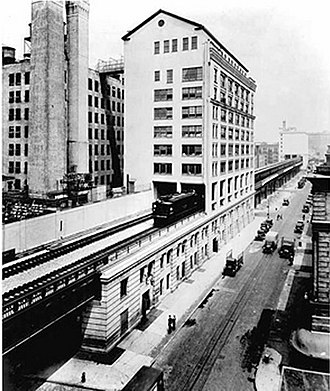New York Central Railroad - A New York Central train running on the High Line through the Bell Laboratories Building, 1936