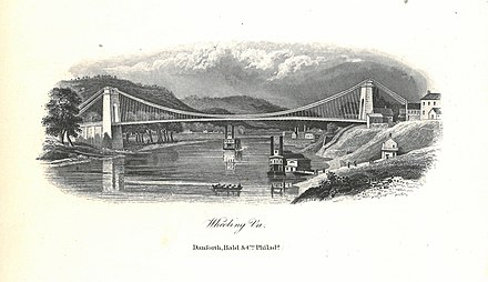 Built between 1847 and 1849, the Wheeling Suspension Bridge was the first bridge across the river and a crucial part of the National Road. Wheeling Suspension Bridge Lithograph.jpg