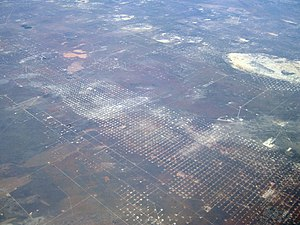 Wickett, Texas - Oblique air photo of Wickett, facing northeast, showing a multitude of natural gas wells, in 2011