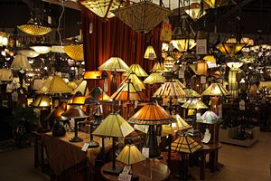 A wide array of lamps and light fixtures on di...