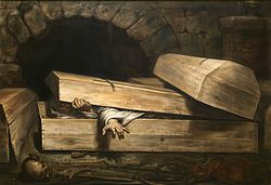 A wooden coffin in a stone vault being opened by a shrouded figure inside.
