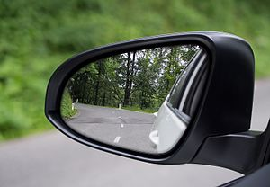 Wing mirror - Dual-contour wing mirror. Large inboard convex surface is separated from small outboard aspheric surface.