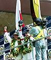 Winners Hurley Haywood, Mauro Baldi & Yannick Dalmas on the podium at the 1994 Le Mans (31596542460).jpg