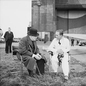 Alex Henshaw -  Prime Minister Winston Churchill talking to Alex Henshaw, after a 1941 demonstration flight on a Spitfire. Source: Imperial War Museum online collection IWM Collection No.H 14264