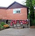 Wreaths on an Aberbargoed War Memorial wall (geograph 6258092).jpg