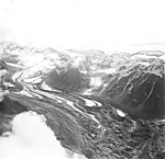 Yanert Glacier, valley glacier with winding moraines and rock covered terminus, circa August 1968 (GLACIERS 5116).jpg