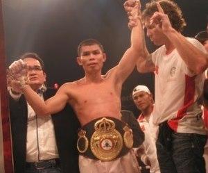 Chris John (boxer) - John (center) with the WBA title