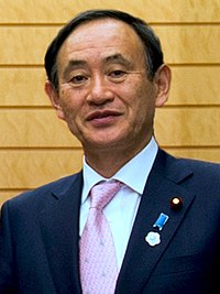 Yoshihide Suga cropped 3 Joint Press Announcement of the Okinawa Consolidation Plan.jpg