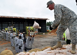 Youth Challenge Program - Image: Youth Challenge Academy cadet throws a sandbag to Georgia State Defense Force Cpl. Richard Wilson