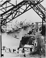 """""""Victory cargo ships are lined up at a U.S. west coast shipyard for final outfitting before they are loaded with supplie - NARA - 535970.jpg"""