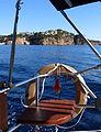 009 Navegant vora Sant Feliu de Guíxols, al fons el puig de les Forques.JPG