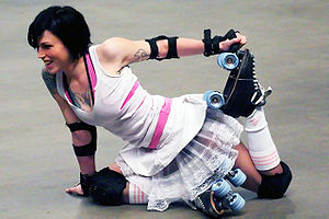 Stretching - A roller derby athlete stretching.