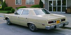 1975 AMC Matador base Sedan beige left-rear.jpg