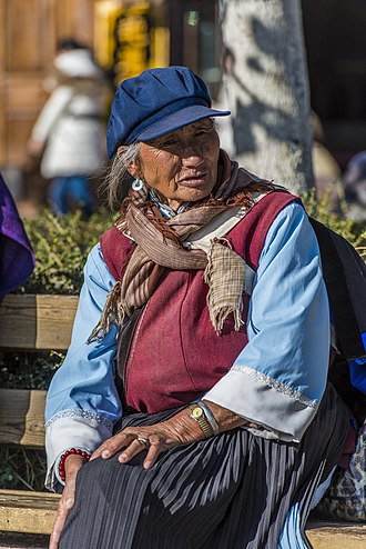Old Town of Lijiang - A Nakhi old woman in the town square