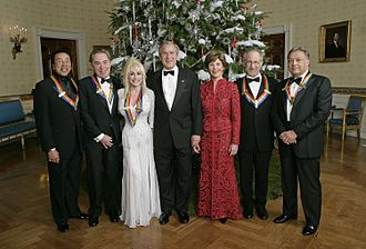 "Andrew Lloyd Webber - U.S. President George W. Bush and First Lady Laura Bush stand with the Kennedy Center honourees in the Blue Room of the White House during a reception Sunday, 3 December 2006. From left, they are: singer and songwriter William ""Smokey"" Robinson; Andrew Lloyd Webber; country singer Dolly Parton; film director Steven Spielberg; and conductor Zubin Mehta."