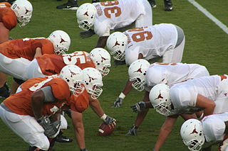 Line of scrimmage Imaginary transverse line in American football, beyond which a team cannot cross until the next play has begun