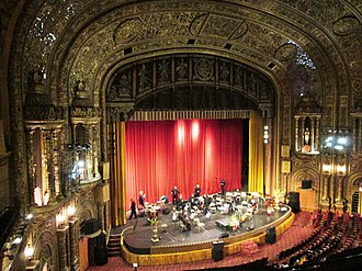 United Palace - The proscenium and stage of the United Palace; the stage is set up for an orchestral performance