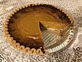 2019-12-25 18 19 56 A pumpkin pie with one large slice removed for Christmas Dinner in the Parkway Village section of Ewing Township, Mercer County, New Jersey.jpg