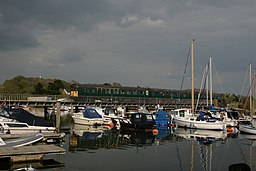 3CIG 1498, among the yachts, rumbles over the bridge at Lymington Town. - panoramio