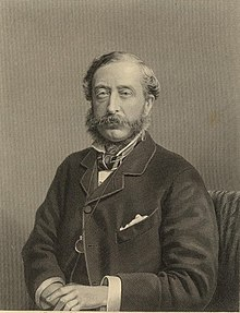 A middle-aged man, with sideburns and moustache, wearing a dark suit with a wing-collared shirt and cravat; a monocle hangs from a chain around his neck