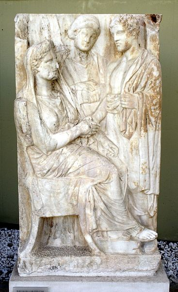 Woman greeting her son; between them, a female slave (4th century BCE)