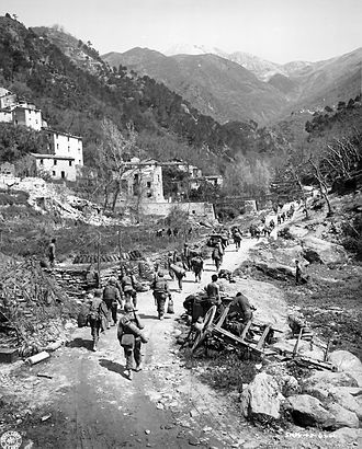 92nd Infantry Division (United States) - Soldiers of the 92nd Infantry Division pursue the retreating Germans through the Po Valley, Italy, April 1945.