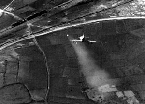 Operation Rolling Thunder - A U.S. Navy Douglas A-4 Skyhawk attacking a train in North Vietnam with a Zuni rocket
