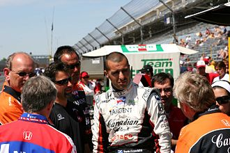 Andretti Autosport - Members of Andretti Green Racing have a meeting on pit road at the Indianapolis Motor Speedway in May 2007.