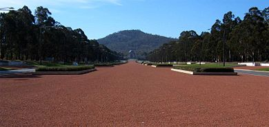Overlooking the gravel of ANZAC Parade with the Australian War Memorial and Mount Ainslie in the distance