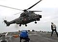 A Chilean Navy SH-32 Super Puma helicopter landing onUSS Mitscher (DDG 57).jpg
