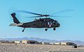 A U.S. Army UH-60 Black Hawk helicopter assigned to Charlie Company, 1st Battalion, 168th Aviation Regiment, California Army National Guard takes off on a mission at Shindand Air Base in Herat province 131208-Z-HP669-012.jpg