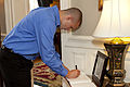 A family member of honorary Marine Daran Wankum, not shown, signs a guest book at the Home of the Commandants at Marine Barracks Washington in Washington, D.C., June 13, 2013 130613-M-KS211-064.jpg