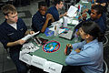 A group of U.S. Sailors sits with Educational Services Office (ESO) advisers at a career fair aboard aircraft carrier USS Ronald Reagan (CVN 76) Aug. 22, 2009, in the Gulf of Oman 090822-N-RJ456-129.jpg