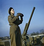 A member of the ATS (Auxiliary Territorial Service) serving with a 3.7-inch anti-aircraft gun battery, December 1942. TR460.jpg