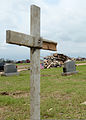 A pile of debris sits near gravestones in Moore, Okla., May 26, 2013, six days after an EF5 tornado with winds exceeding 200 miles per hour tore through the Oklahoma City suburb 130526-Z-TK779-054.jpg