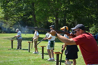 Trap shooting - An image of the typical trap shoot line at an amateur event.