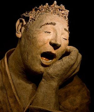 English: Aching tooth: This statue is in the w...