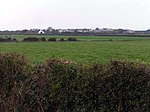Across the fields to Mawbray. The flat topography is very obvious from this shot