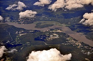 """Aerial view of West Point, 2013. West Point is at center on the near (western) side of the river. <a href=""""http://search.lycos.com/web/?_z=0&q=%22Highland%20Falls%2C%20New%20York%22"""">Highland Falls</a> is at right; <a href=""""http://search.lycos.com/web/?_z=0&q=%22Cold%20Spring%2C%20New%20York%22"""">Cold Spring</a> is at left, across the river in <a href=""""http://search.lycos.com/web/?_z=0&q=%22Putnam%20County%2C%20New%20York%22"""">Putnam County</a>."""