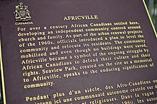 "Text reads ""For over a century African Canadians settled here, developing an independent community centred around church and family. As part of the urban renewal projects of the 1960s, officials introduced a plan to level the community and relocate its residents. The community mobilized and even though no buildings were saved, Africville became a smybol of the ongoing struggle by African Canadians to defend their culture and their rights. Seaview Park, created on the site as a memorial to Africville, speaks to the enduring significance of community."""