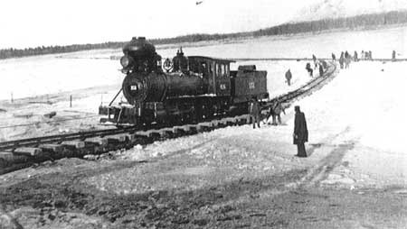 Alaska Railroad engine crossing the Tanana River on the ice at Nenana just prior to completion of the railroad