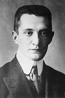 Head and shoulders black-and-white photograph of a clean-shaven Kerensky in his late-thirties/early-forties with dark eyes and hair