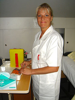 A nurse working in a hospital.