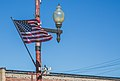 American Flag in small town - Calumet Township, Keweenaw Peninsula, Upper Peninsula, Michigan (30597227010).jpg