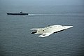 An X-47B Unmanned Combat Air System demonstrator flies near the aircraft carrier USS George H.W. Bush.jpg