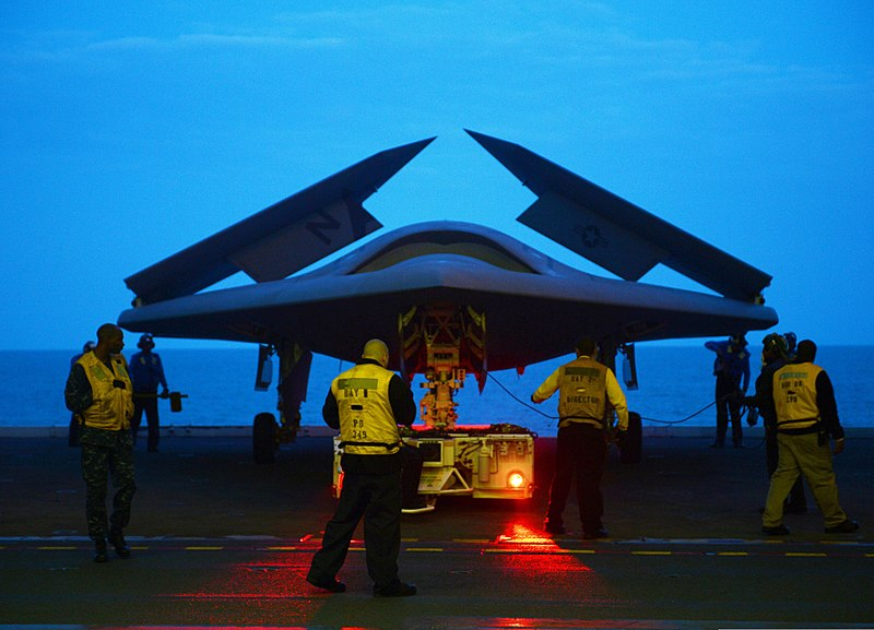 File:An X-47B unmanned combat air system is towed into the hangar bay of the aircraft carrier USS George H.W. Bush (CVN 77) in the Atlantic Ocean May 13, 2013 130513-N-FU443-020.jpg