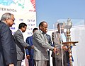 Anant Geete and the Union Minister for Road Transport & Highways and Shipping, Shri Nitin Gadkari lighting the lamp to inaugurate the Auto Expo 2016, at Greater Noida, UP on February 04, 2016.jpg