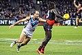 Anthony McDonald-Tipungwuti handballing away from Matthew Broadbent.jpg